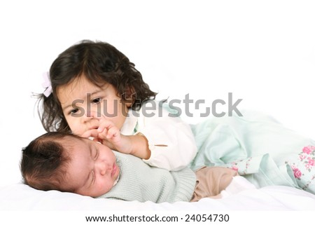 Brother and sister (two under 2) (focus on the boy) - stock photo