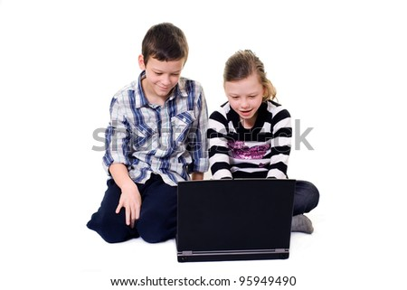 brother and sister using a computer