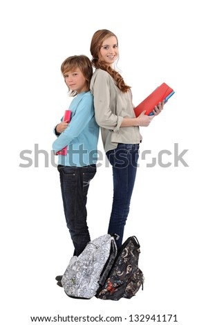 Brother and sister with homework - stock photo