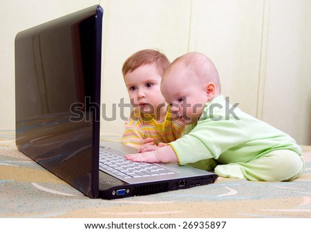 Brother and sister with laptop.Little girl and boy using laptops