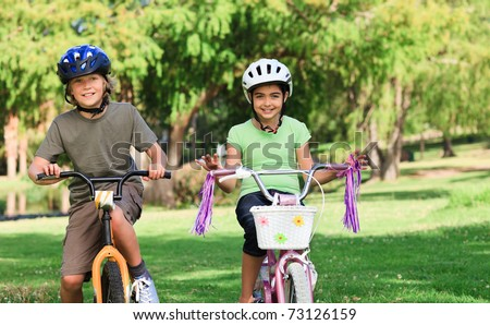 Brother and  sister with their bikes