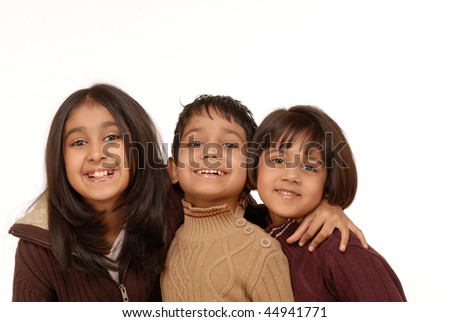 brother and sisters isolated on white background - stock photo