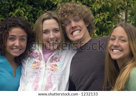 brother and sisters laughing,