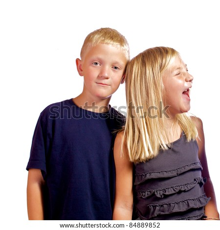 Brother annoyed with his sister as she hysterically laughs with him. - stock photo