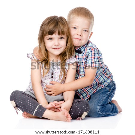 brother hugging little sister . isolated on white background - stock photo