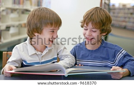 Brother Reading a Book - stock photo