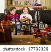 brother, sister and presents on a couch - stock photo