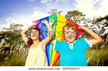 Brother Sister Sibling Playing Kite Park Concept - stock photo
