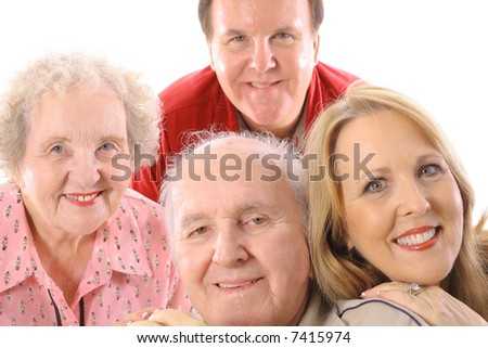 brother & sister with elderly parents - stock photo