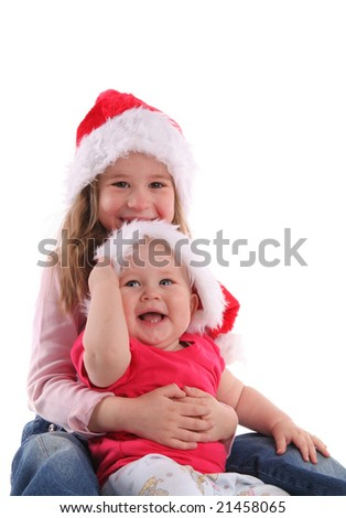 Brother with sister in Christmas hats - stock photo