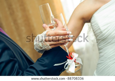brotherhood drink. wedding hands with champagne glasses
