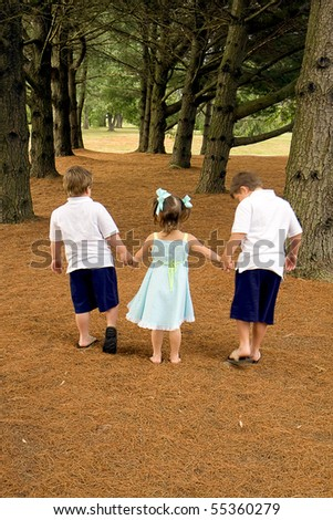 Brothers and their sister enjoying each other's company outdoors