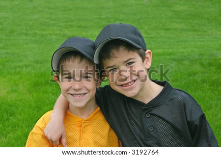 Brothers In Baseball Uniforms - stock photo