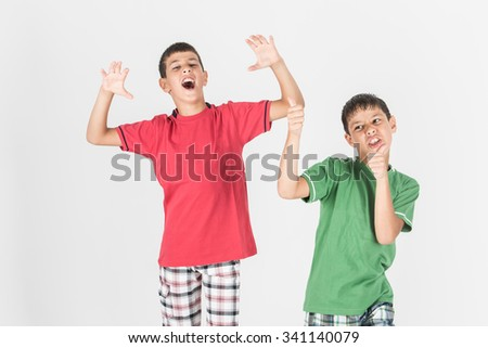 Brothers or friend kids with wild body gesture - stock photo
