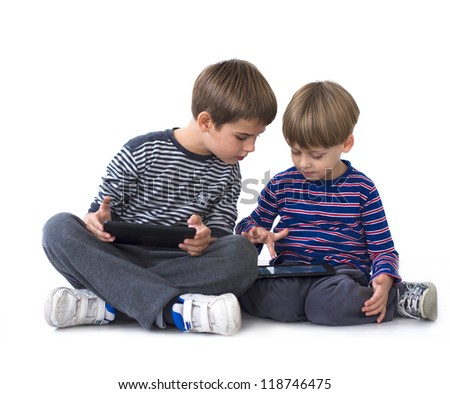 brothers playing games on tablets - stock photo