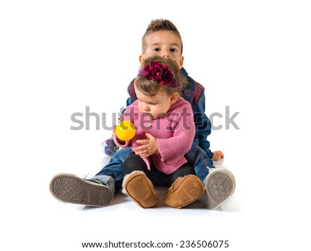 Brothers playing over white background