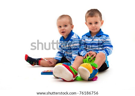 brothers playing together - stock photo