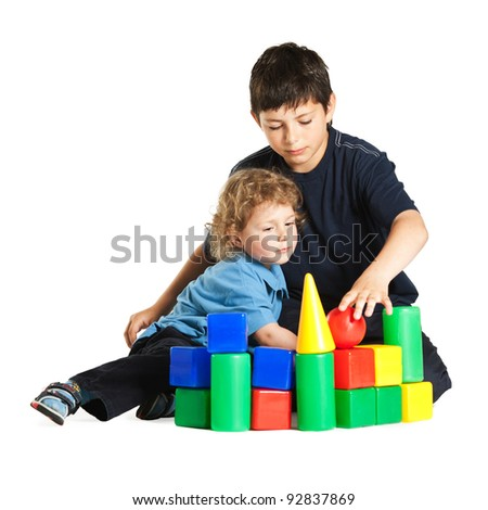 brothers playing with blocks - stock photo