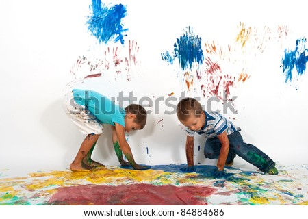 Brothers playing with colors. - stock photo