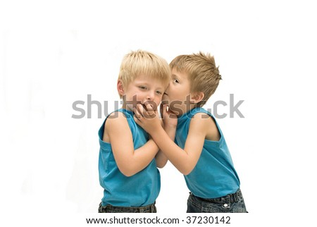 Brothers sharing a secret. - stock photo