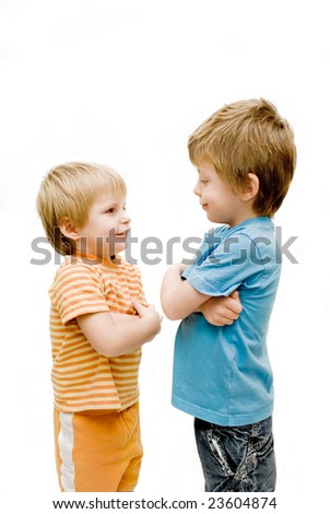 Brothers standing and facing each other, looking happy. - stock photo
