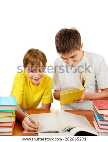 Brothers with the Books doing Homework on the White Background - stock photo
