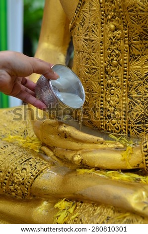 Brought Buddha temple blessings on Songkran in Thailand. - stock photo