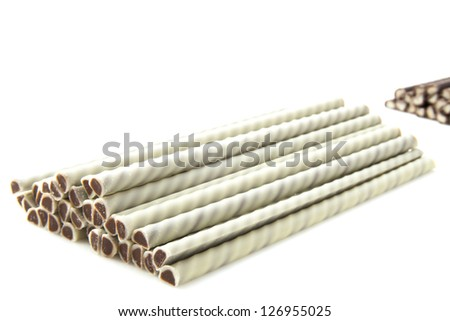 Brown and white filled chocolate sticks for background use
