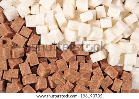Brown and white refined sugar as background - stock photo