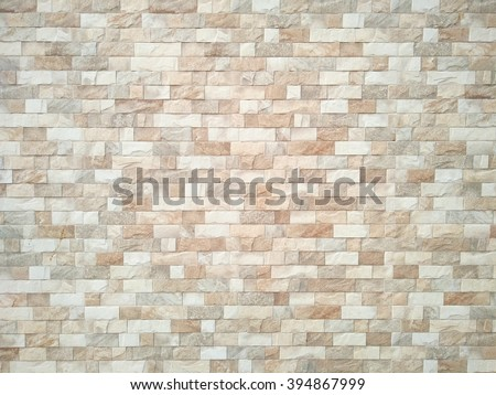 Brown and white Stone ceramic Brick wall beautiful color texture background for art interiors design in home, house, building, shop, store, art store, coffee shop - stock photo