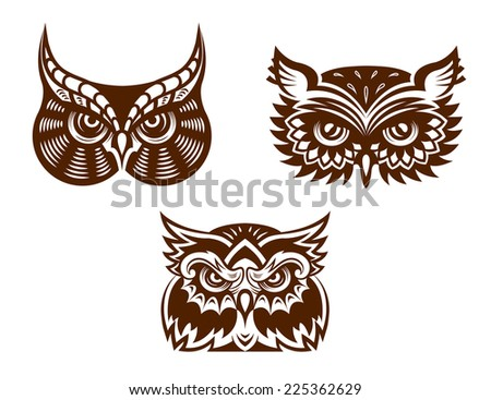 Brown and white wise old owl faces with decorative feather detail for tattoo or mascot design - stock photo