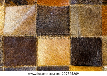 Brown animal fur made from patches and parts  - stock photo