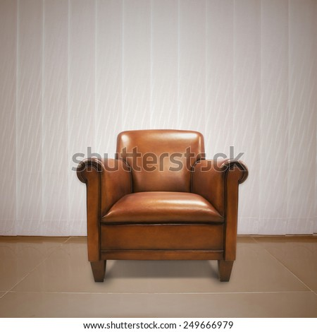 Brown antique leather chair with curtains on the back for an elegant interior