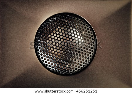 brown audio tweeter with grill mesh - stock photo