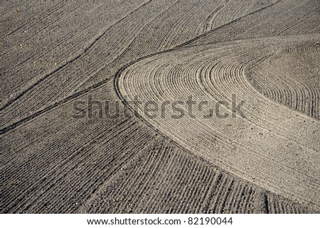 Brown background of plowed field with interesting pattern - stock photo