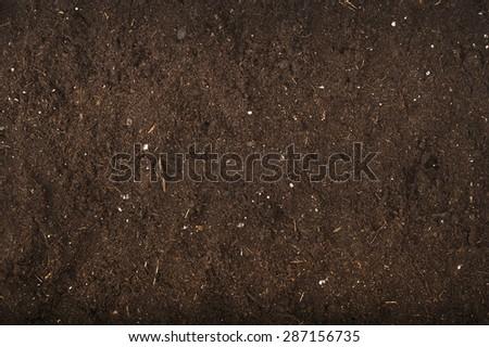 brown background of soil for gardening studio shoot - stock photo