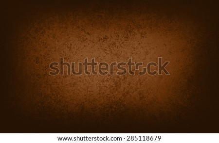 brown background with center spotlight and black vignette border, rich luxury coffee color brown background - stock photo