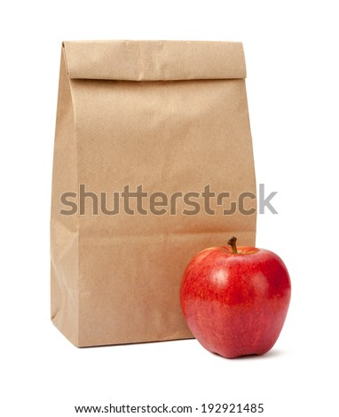 Brown Bag Lunch with a red apple, isolated with a clipping path, on a white background. - stock photo