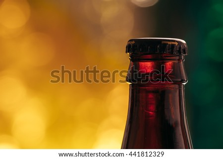 brown beer bottle on a blurred background. - stock photo