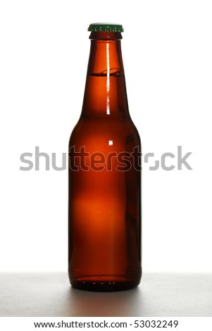 Brown beer bottle with green cap on white background - stock photo