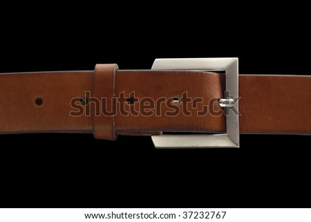 brown belt with buckle isolated on black background with clipping path - stock photo