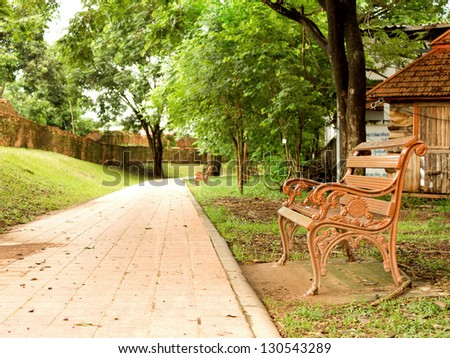 brown bench in the park, Thailand - stock photo