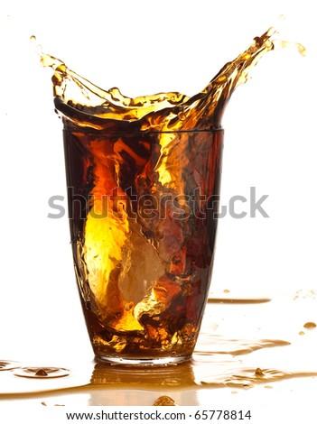 brown beverage splash on a white background - stock photo