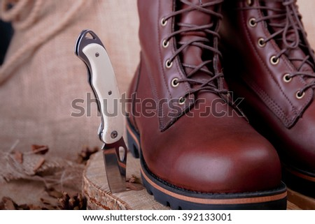 Brown boots on a wooden surface