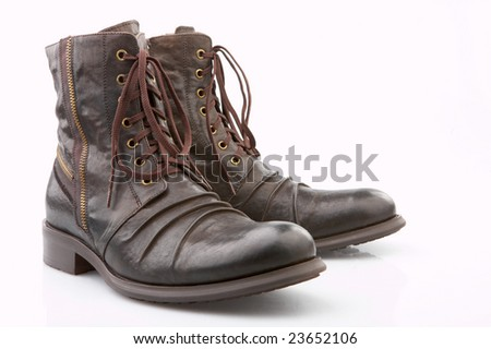 Brown boots on the white background, isolated