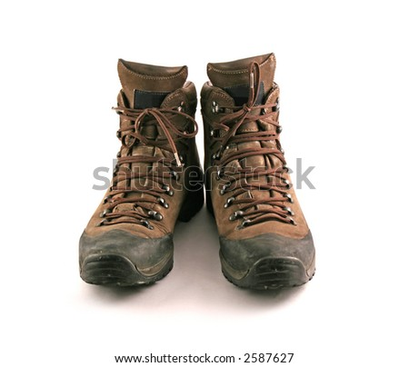 Brown boots set on a white background