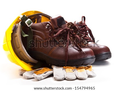 Brown boots with laces for work, yellow hard hat, gloves on a white background - stock photo