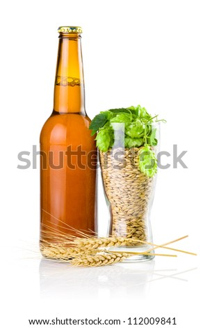 Brown bottle of beer, Glass full of barley and hops, Wheat ears isolated on white background - stock photo