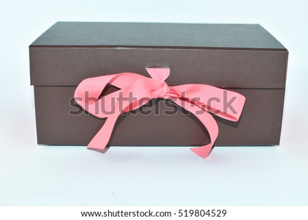 Brown box with a pink bow for gift on a white background