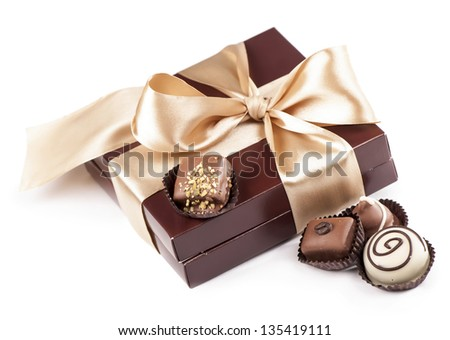 brown box with candies and golden tape - stock photo